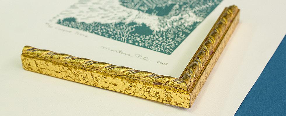 Cornice in Oro